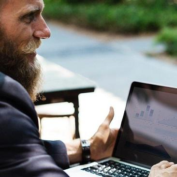 Man with beard typing