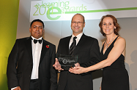 Michael Management CEO Thomas Michael accepts eLearning Company of the Year award